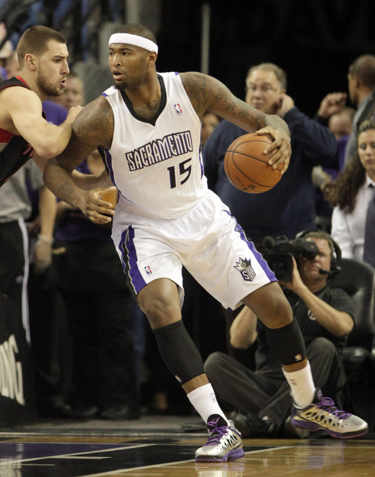 Sacramento Kings center DeMarcus Cousins, right, goes to the basket against Toronto Raptors center Jonas Valanciunas, of Lithuania, during the first quarter of an NBA basketball game in Sacramento, Calif., Wednesday, Dec. 5, 2012. (AP Photo/Rich Pedroncelli)
