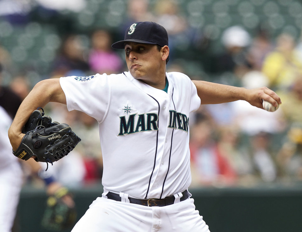 Photo -   Seattle Mariners starter Jason Vargas delivers a pitch during the third inning of a baseball game against the Oakland Athletics in Seattle, Sunday, Sept. 9, 2012. (AP Photo/Stephen Brashear)