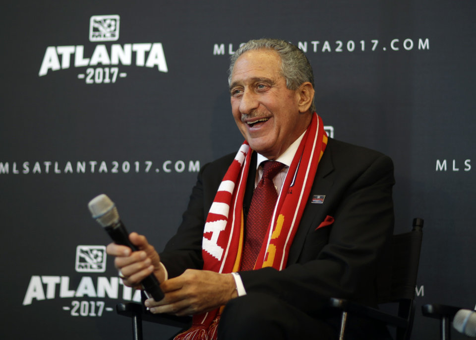 Photo - Atlanta Falcons owner Arthur Blank smiles during a news conference announcing the city is getting a Major League Soccer expansion team on Wednesday, April 16, 2014, in Atlanta. MLS announced its newest franchise, unveiling a the team for Atlanta that will begin play in 2017 at the city's new retractable roof stadium. (AP Photo/David Goldman)