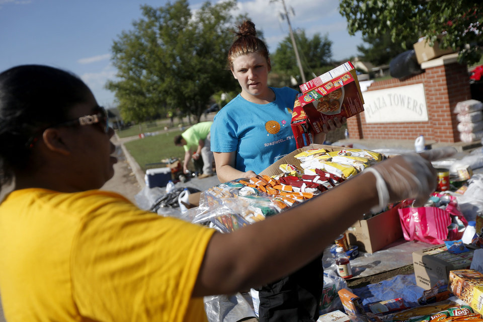 Volunteer Shelby Hays helps organize items for victims outside the Plaza Towers neighborhood in Moore, Okla., on Wednesday, May 22, 2013. A tornado damage the are on Monday, May 20, 2013. Photo by Bryan Terry, The Oklahoman