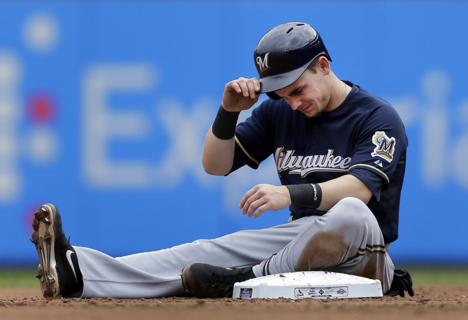 Photo - Milwaukee Brewers' Scooter Gennett removes his helmet after he was caught stealing second to end the top of the third inning of a baseball game against the St. Louis Cardinals Wednesday, April 30, 2014, in St. Louis. (AP Photo/Jeff Roberson)