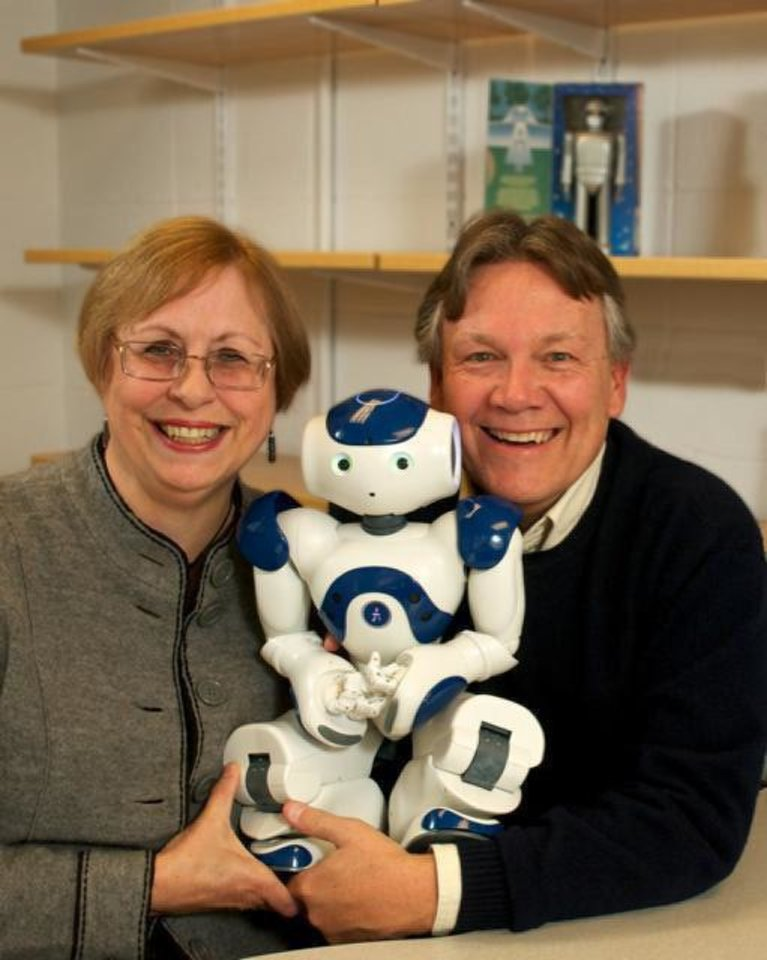 Susan and Mike Anderson with their Nao robot, which they have programmed to behave ethically within a specific scenario. <strong>Shana Sureck - University of Hartford</strong>