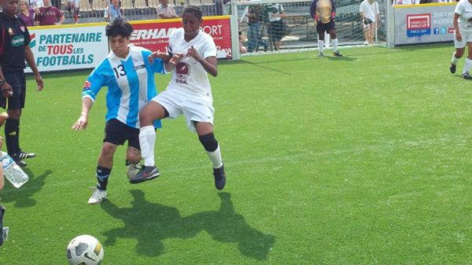 Photo - Rudy Crenshaw, right, battles for the ball at the Homeless World Cup last summer in Paris. Crenshaw, a former Clinton High School basketball star, credits the experience with turning her life around and giving her hope of escaping homelessness.   - PHOTO PROVIDED BY STEPHANIE NORRIS