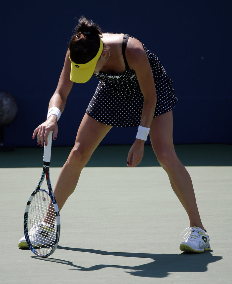 Photo - Agnieszka Radwanska, of Poland,of Australia, reacts after losing a point to Shuai Peng, of China, during the second round of the 2014 U.S. Open tennis tournament, Wednesday, Aug. 27, 2014, in New York. (AP Photo/Elise Amendola)