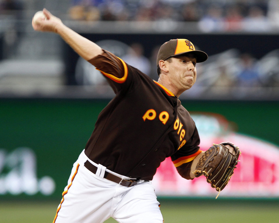Photo - San Diego Padres starting pitcher Tim Stauffer pitches in the first inning of a baseball game against the Chicago Cubs, Friday, May 23, 2014, in San Diego. (AP Photo/Don Boomer)