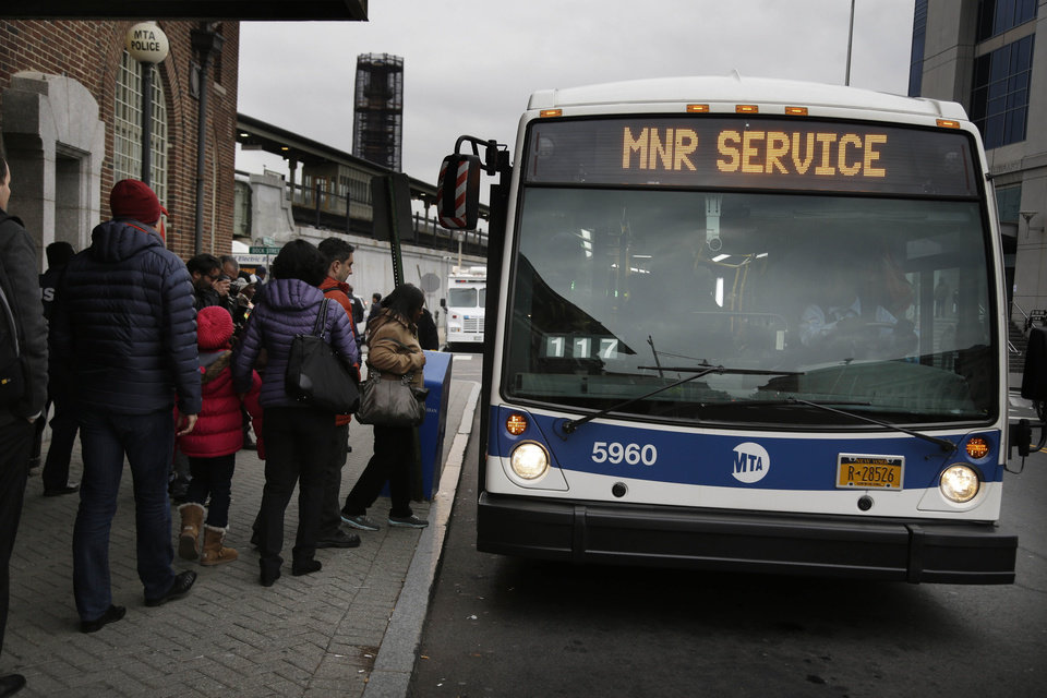 Photo - Because of a train derailment in the Bronx on Sunday, Metro-North commuters switch from the train to shuttle buses in Yonkers, N.Y., Monday, Dec. 2, 2013. Transit officials say Hudson line service will be limited at the start of the work week due to the fatal train derailment. (AP Photo/Seth Wenig)