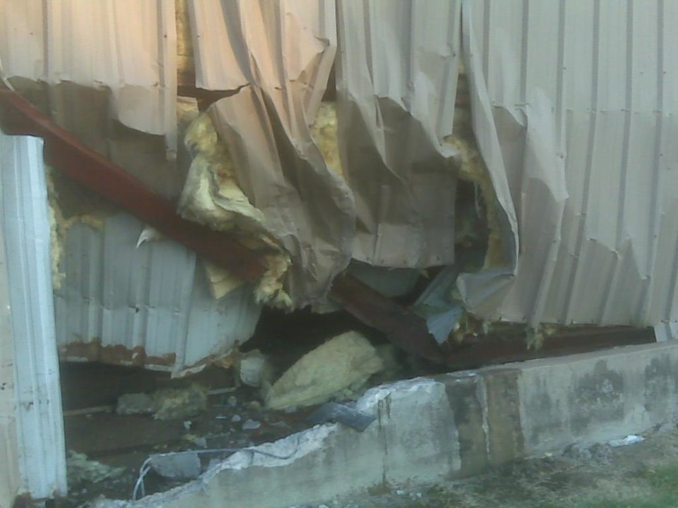 Photo - The side of the automotive building into which a pickup crashed Tuesday morning - Photo by Robert Medley