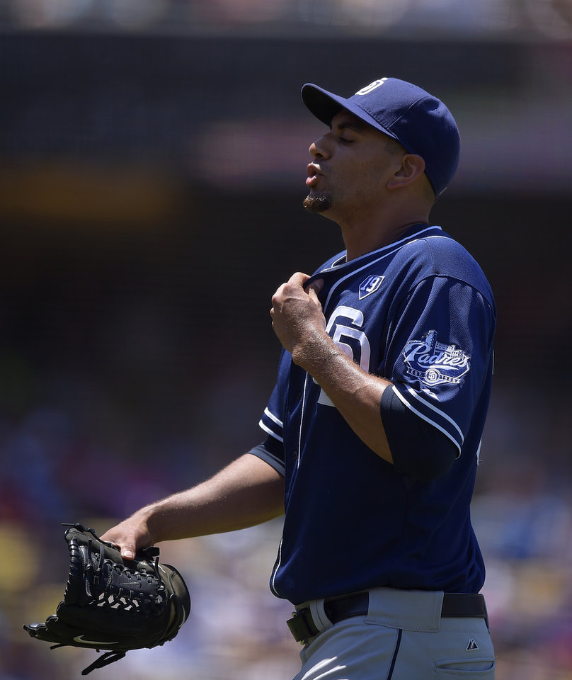 Photo - San Diego Padres starting pitcher Tyson Ross walks off the field after closing out the second inning of a baseball game against the Los Angeles Dodgers, Sunday, July 13, 2014, in Los Angeles. (AP Photo/Mark J. Terrill)