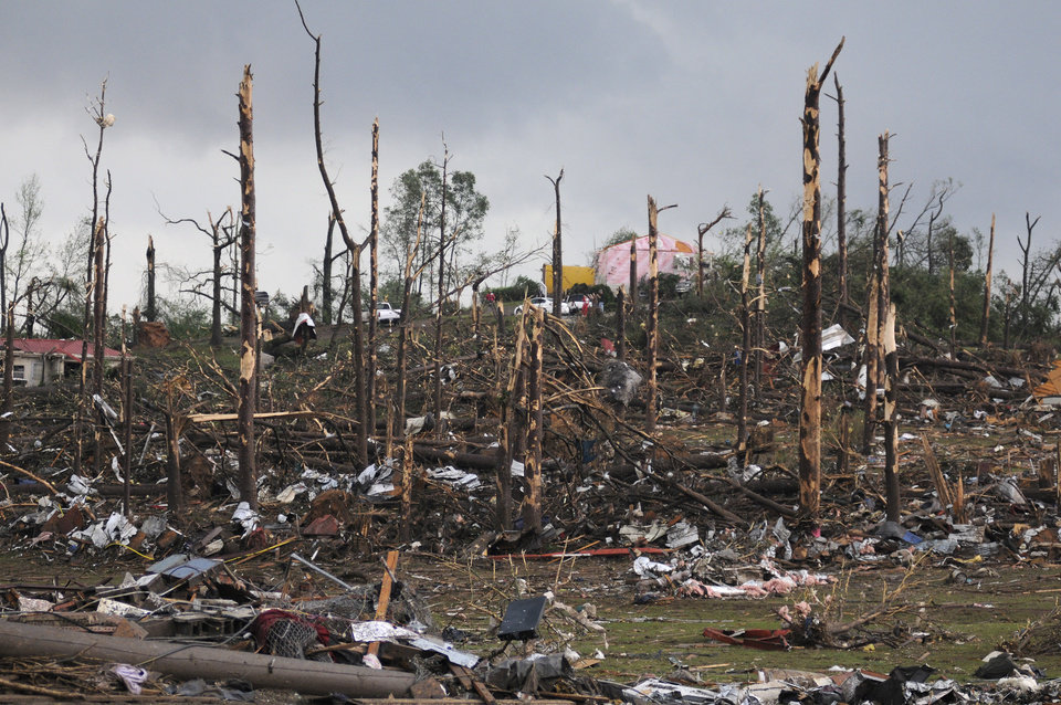 Photo - Extensive damage is seen after what appeared to be a tornado ripped through parts of Concord, Ala., Wednesday, April 27, 2011. A wave of tornado-spawning storms strafed the South on Wednesday, splintering buildings across hard-hit Alabama and killing 72 people in four states. At least 58 people died in Alabama alone. (AP Photo/Birmingham News, Jeff Roberts)