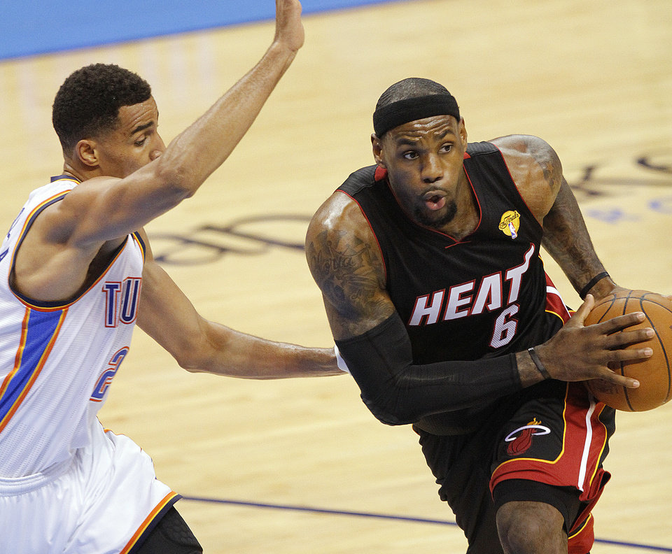 Miami\'s LeBron James (6) drives past Oklahoma City\'s Thabo Sefolosha (2) during Game 2 of the NBA Finals between the Oklahoma City Thunder and the Miami Heat at Chesapeake Energy Arena in Oklahoma City, Thursday, June 14, 2012. Photo by Chris Landsberger, The Oklahoman