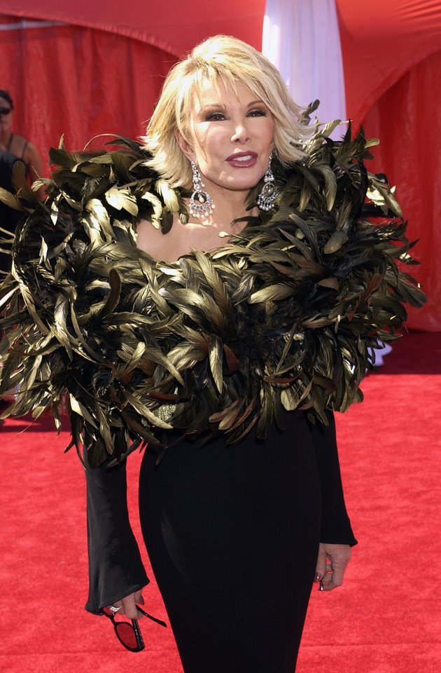 Photo - FILE - In this Sept. 21, 2003 file photo, comedian and TV personality Joan Rivers with E! Entertainment television arrives for the 55th Annual Primetime Emmy Awards in Los Angeles. Rivers, the raucous, acid-tongued comedian who crashed the male-dominated realm of late-night talk shows and turned Hollywood red carpets into danger zones for badly dressed celebrities,  died Thursday, Sept. 4, 2014. She was 81. Rivers was hospitalized Aug. 28, after going into cardiac arrest at a doctor's office. (AP Photo/Laura Rauch, File)
