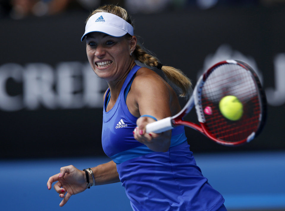 Photo - Angelique Kerber of Germany makes a forehand return to Flavia Pennetta of Italy during their fourth round match at the Australian Open tennis championship in Melbourne, Australia, Sunday, Jan. 19, 2014.(AP Photo/Eugene Hoshiko)