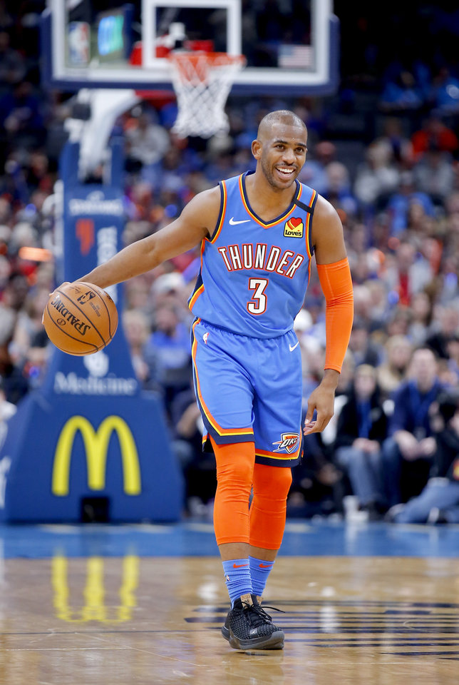 Photo - Oklahoma City's Chris Paul (3) laughs as he brings the ball up court during the NBA basketball game between the Oklahoma City Thunder and the Portland Trail Blazers at the Chesapeake Energy Arena in Oklahoma City, Saturday, Jan. 18, 2020.  [Sarah Phipps/The Oklahoman]
