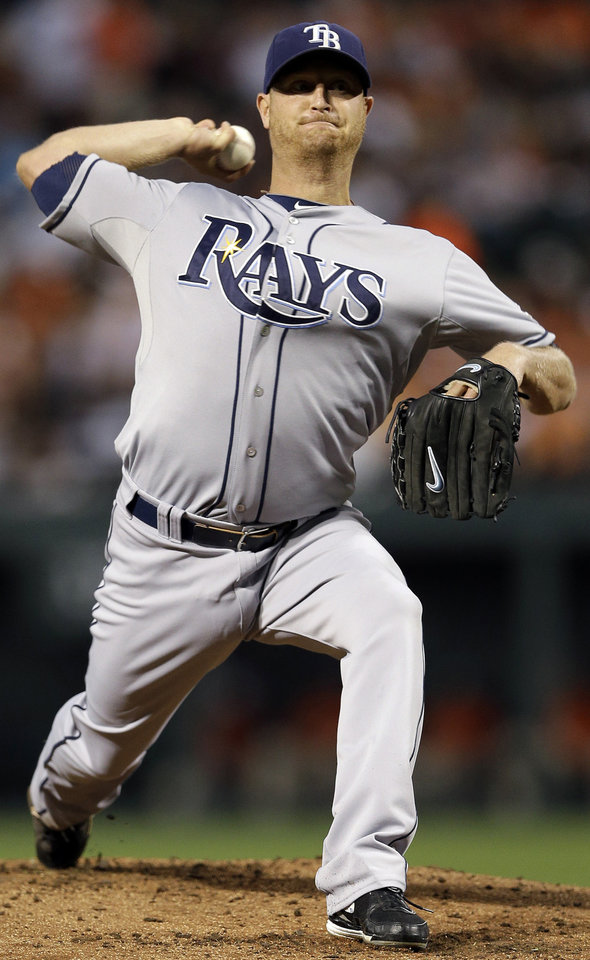 Photo -   Tampa Bay Rays starting pitcher Alex Cobb throws to the Baltimore Orioles in the first inning of a baseball game in Baltimore, Wednesday, Sept. 12, 2012. (AP Photo/Patrick Semansky)