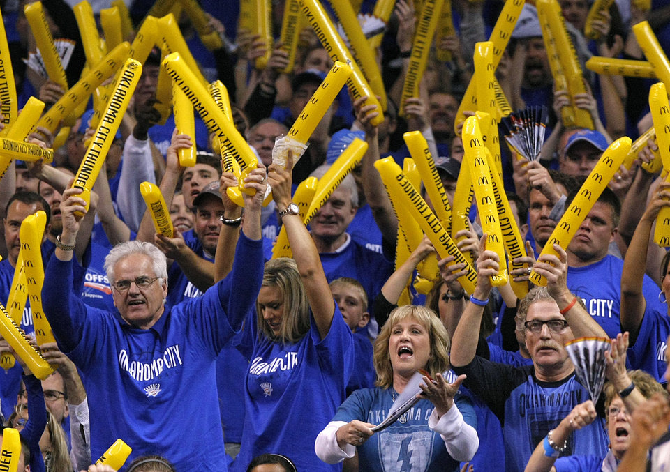 Photo - Thunder fans cheer during game one of the Western Conference semifinals between the Memphis Grizzlies and the Oklahoma City Thunder in the NBA basketball playoffs at Oklahoma City Arena in Oklahoma City, Sunday, May 1, 2011. Photo by Chris Landsberger, The Oklahoman