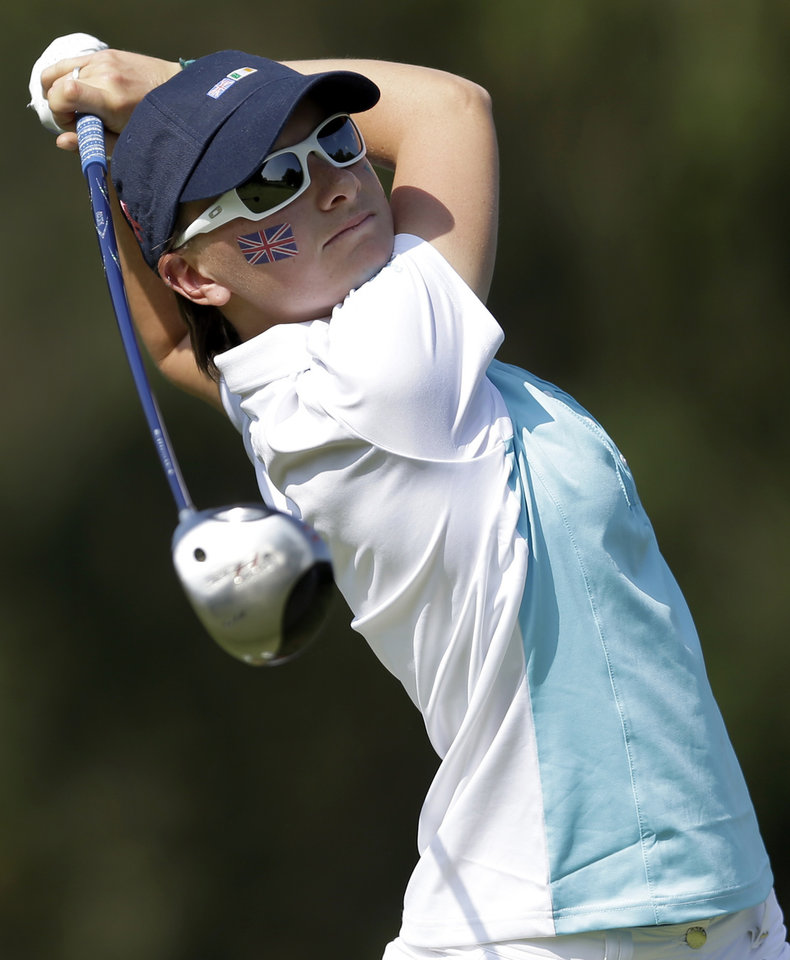 Photo - Great Britain and Ireland's Charlotte Thomas tees off on the sixth hole during the 38th Curtis Cup amateur golf match Friday, June 6, 2014, in St. Louis. (AP Photo/Jeff Roberson)
