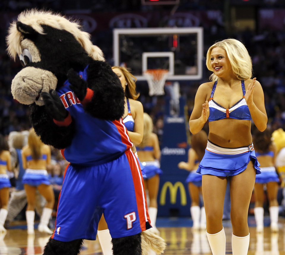 Photo - The Thunder Girls dance team performs with visiting mascots during an NBA basketball game between the Memphis Grizzlies and the Oklahoma City Thunder at Chesapeake Energy Arena in Oklahoma City, Friday, Feb. 28, 2014. Photo by Nate Billings, The Oklahoman