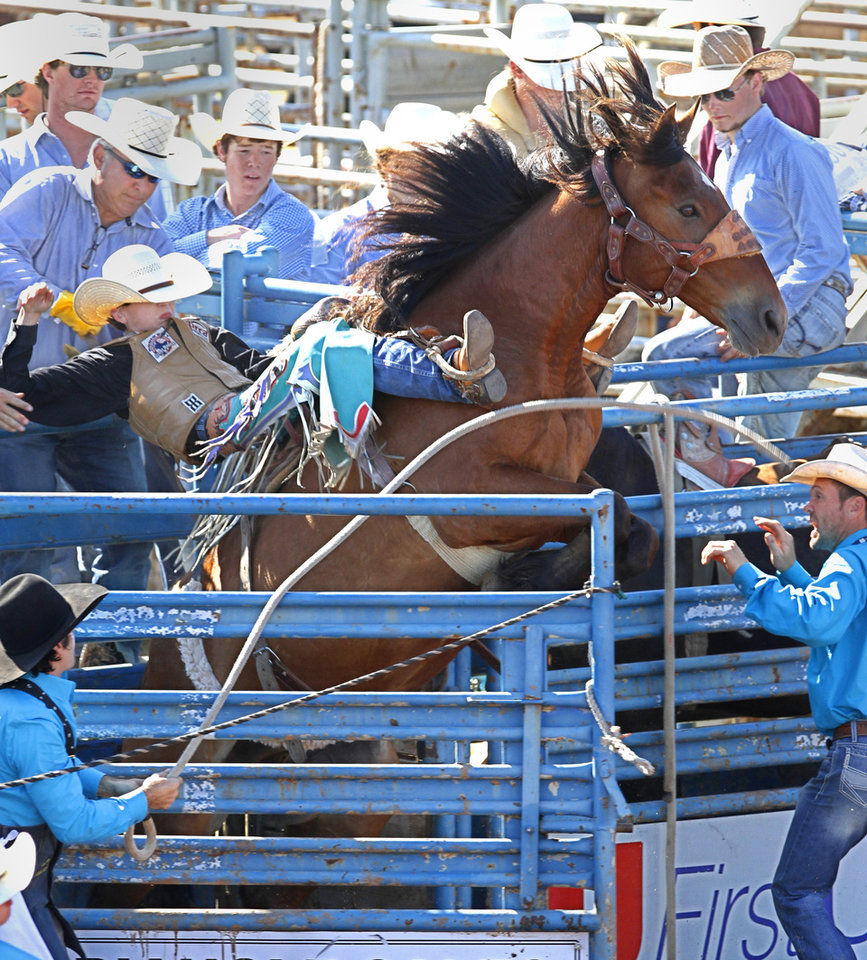 Jake Barnes, from Springdale, AR, in the Saddle Bronc at the International Finals Youth Rodeo in Shawnee, Friday, July 11, 2014.   Photo by David McDaniel, The Oklahoman
