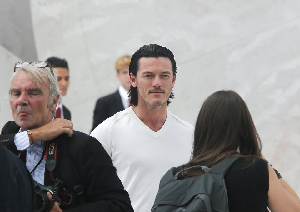Photo - British actor Luke Evans, center, arrives to Louis Vuitton men's spring-summer 2015 fashion collection in Paris, France, Thursday, June 26, 2014. (AP Photo/Jacques Brinon)