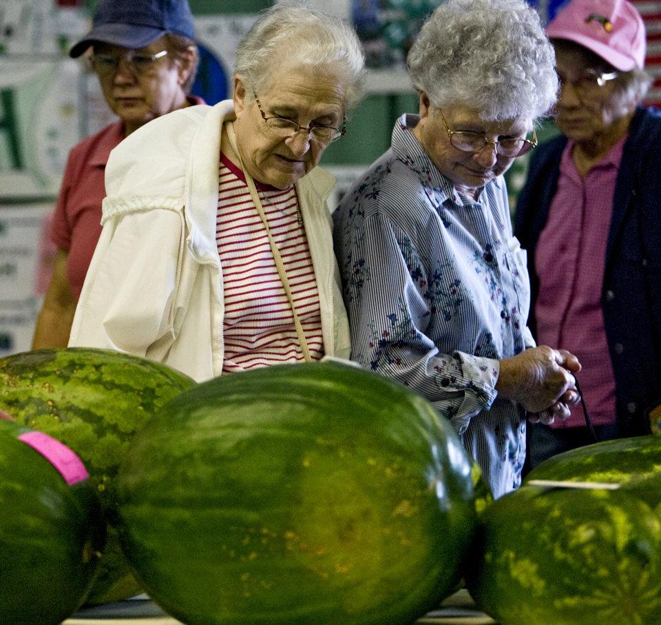 Photo - Fair participants check out the prize-winning produce at the 2009 Oklahoma State Fair at State Fair Park on Wednesday, Sept. 23, 2009, in Oklahoma City, Okla.  Photo by Chris Landsberger, The Oklahoman.