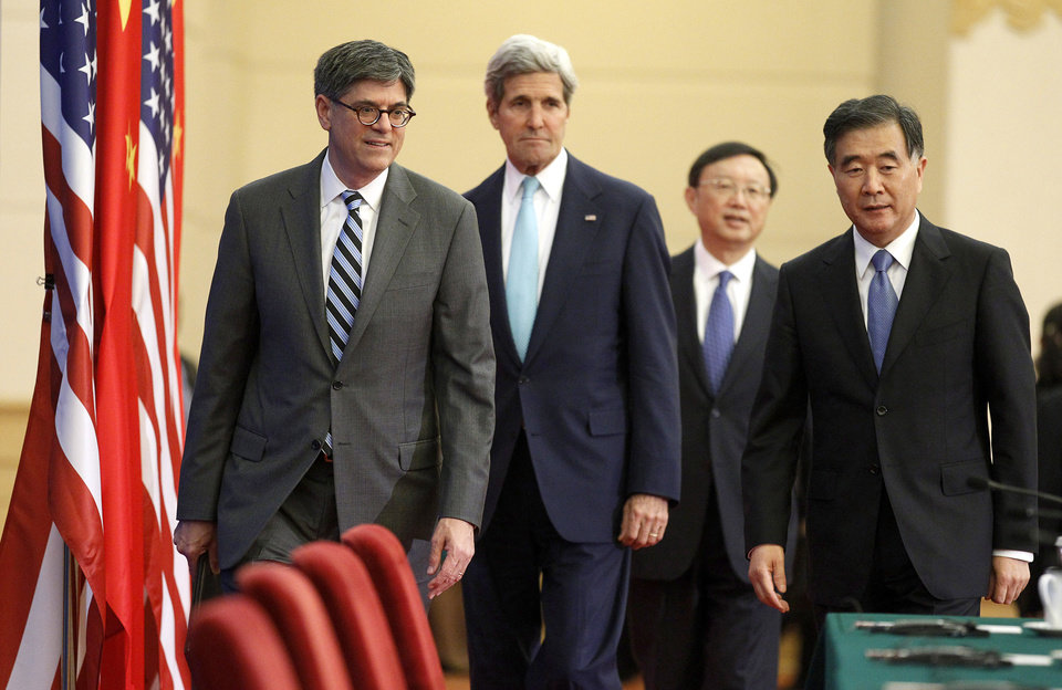 Photo - Left to right: U.S. Treasury Secretary Jack Lew, Secretary of State John Kerry, China's State Councilor Yang Jiechi and Vice Premier Wang Yang arrive to deliver joint statements at the Great Hall of the People in Beijing Thursday, July 10, 2014. The leaders were concluding the sixth round of U.S.-China Strategic and Economic Dialogue.  (AP Photo/Jim Bourg, Pool)