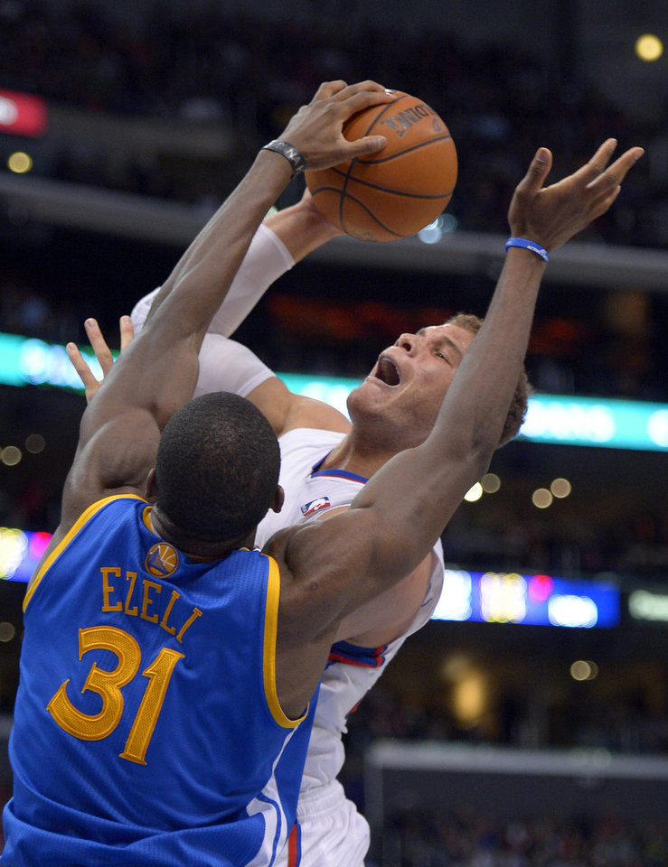 Los Angeles Clippers forward Blake Griffin, right, is blocked by Golden State Warriors center Festus Ezeli, of Nigeria, during the first half of their NBA basketball game, Saturday, Jan. 5, 2013, in Los Angeles.  (AP Photo/Mark J. Terrill)