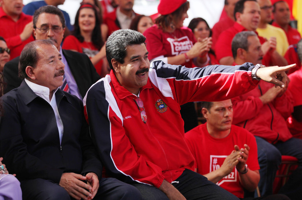Nicaragua's President Daniel Ortega, left, listens to Venezuela's Vice President Nicolas Maduro during a symbolic inauguration for President Hugo Chavez outside Miraflores presidential palace in Caracas, Venezuela, Thursday, Jan. 10, 2013. Venezuela gathered foreign allies and tens of thousands of exuberant supporters Thursday to celebrate a new term for a leader too ill to return home for a real swearing in. The Venezuelan leader, normally at the center of national attention, is so ill following a fourth cancer surgery in Cuba that he has made no broadcast statement in more than a month nor appeared in a single photo. Officials have not specified what sort of cancer he suffers or which hospital is treating him. (AP Photo/Fernando Llano)