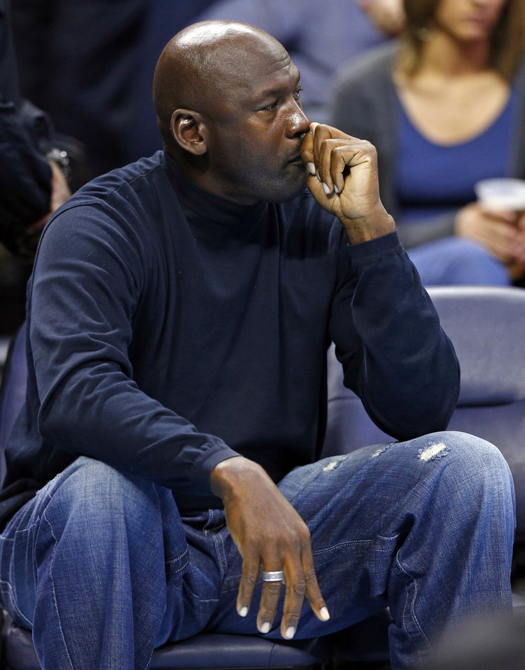 Charlotte Bobcats owner Michael Jordan looks on during the first half of an NBA basketball game between the Charlotte Bobcats and the Indiana Pacers in Charlotte, N.C., Tuesday, Jan. 15, 2013. (AP Photo/Chuck Burton)