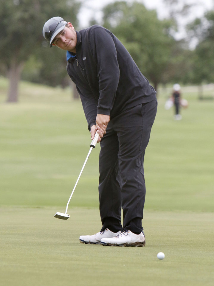 Photo - Newcastle's Sean Glass hits a long putt during the class 4A boy's state golf tournament at the Lake Hefner Golf Course in Oklahoma City, OK, Monday, May 12, 2014,  Photo by Paul Hellstern, The Oklahoman
