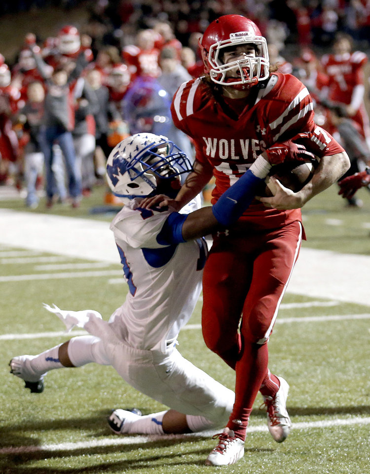 Photo - Davis' Blake Summers gets by Millwood's Alfonzo McMillian to score the game-winning touchdown during the Class 2A state football championship game between Davis and Millwood at Moore High School in Moore, Okla.,  Thursday, Dec. 19, 2013. Photo by Sarah Phipps, The Oklahoman