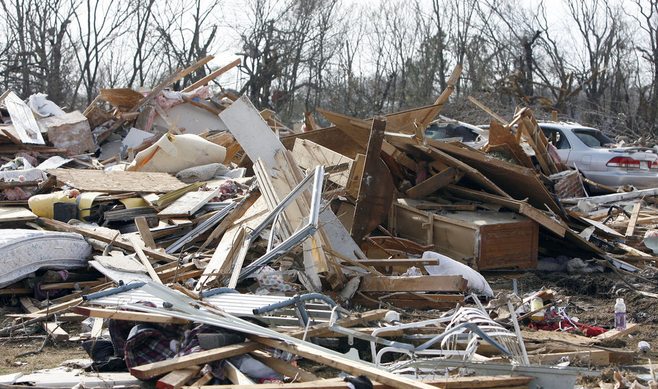 Photo - A home is seen damaged by a tornado in the Majestic Hills neighborhood north of Ardmore, Thursday, Feb. 12, 2009, PHOTO BY SARAH PHIPPS, THE OKLAHOMAN
