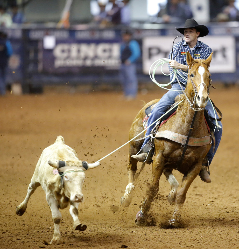 Photo - Roger Nonella of Klamath Falls, Oregon, competes in the heading event during the Timed Event Championship inside the Lazy E Arena in Guthrie, Okla., Friday, March 13, 2020. [Bryan Terry/The Oklahoman]