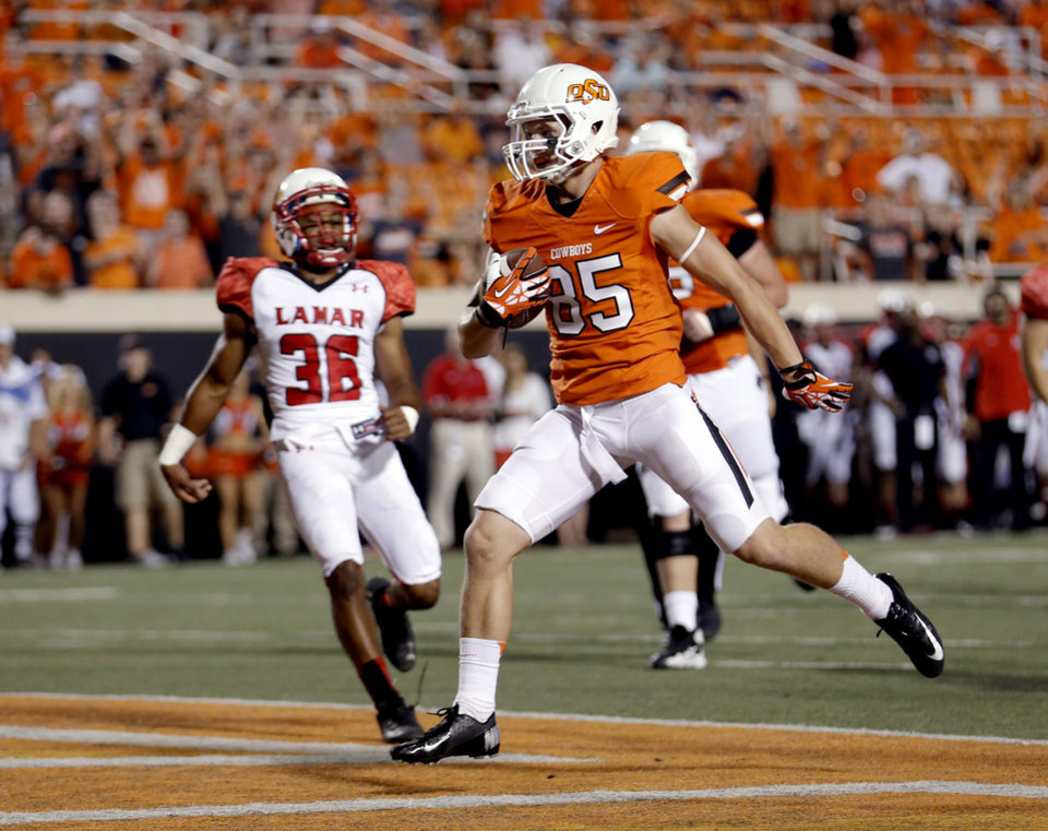 Photo - Oklahoma State's Blake Webb (85) scores touchdown in the fourth quarter during a college football game between the Oklahoma State University Cowboys (OSU) and the Lamar University Cardinals at Boone Pickens Stadium in Stillwater, Okla., Saturday, Sept. 14, 2013. Photo by Sarah Phipps, The Oklahoman
