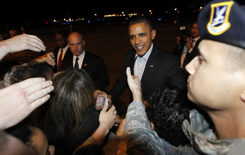 President Barack Obama greets guests on the tarmac upon arrival at Tinker Air Force Base in Oklahoma City, Okla., Wednesday, March, 21, 2012. (AP Photo/Pablo Martinez Monsivais)