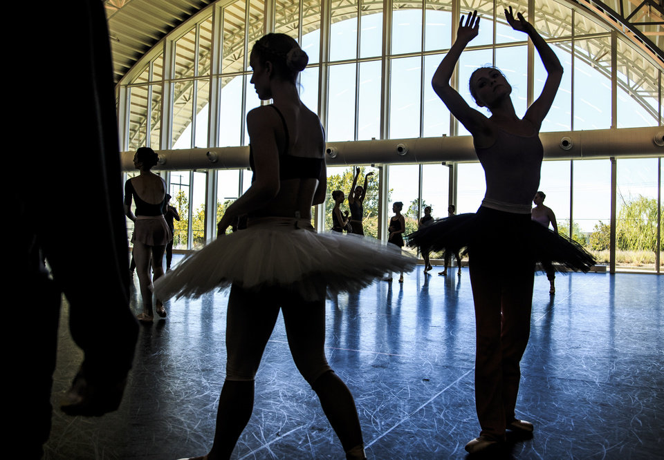 Photo -  Oklahoma City Ballet dancers warm up Monday to rehearse an act of