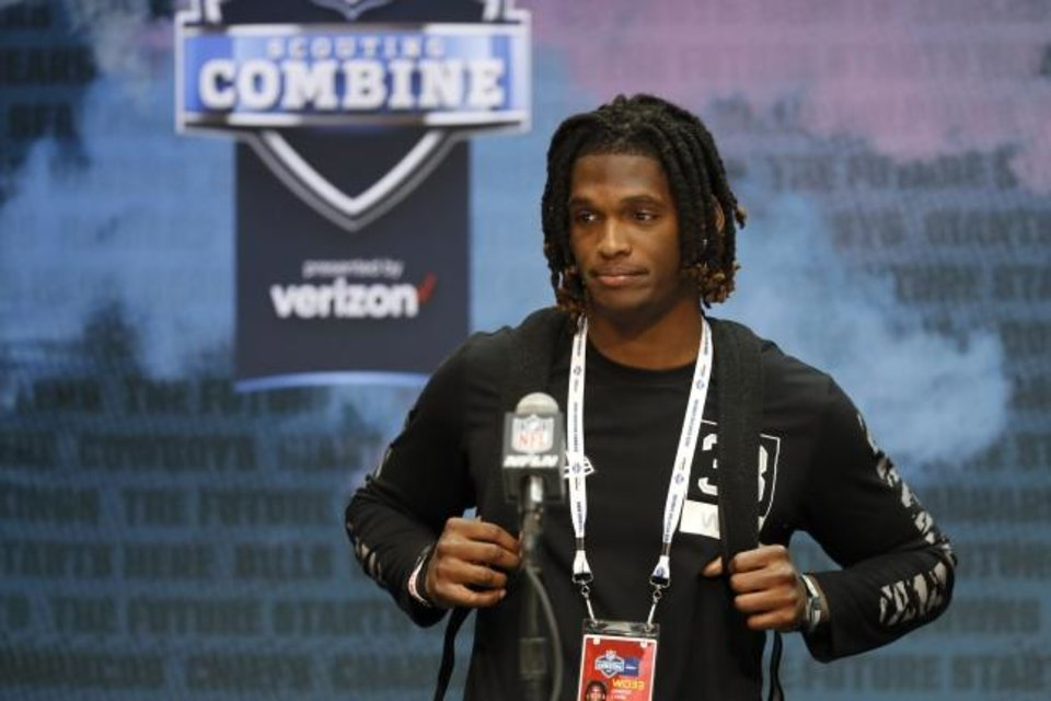 Photo -  OU wide receiver Ceedee Lamb speaks during a press conference at the NFL scouting combine in Indianapolis on Tuesday. [AP Photo/Charlie Neibergall]