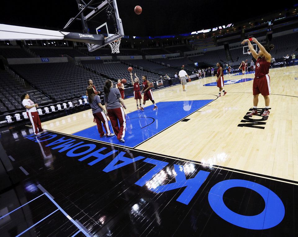 Photo - The OU Sooners warm up for practice during the press conference and practice day at the Oklahoma City Regional for the NCAA women's college basketball tournament at Chesapeake Energy Arena in Oklahoma City, Saturday, March 30, 2013. Photo by Nate Billings, The Oklahoman