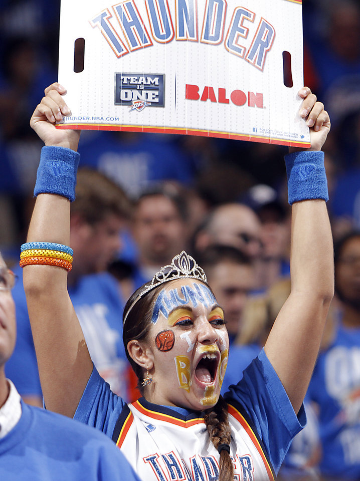 A Thunder fan cheers on her team during Game 1 of the NBA Finals between the Oklahoma City Thunder and the Miami Heat at Chesapeake Energy Arena in Oklahoma City, Tuesday, June 12, 2012. Photo by Chris Landsberger, The Oklahoman
