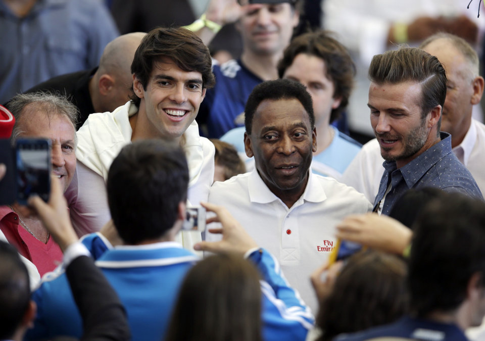 Photo - From left to right Brazil's former soccer player Zico, Brazil's player Kaka, Brazilian soccer legend Pele and former English player David Beckham have their picture taken as they arrive to attend  the World Cup final soccer match between Germany and Argentina at the Maracana Stadium in Rio de Janeiro, Brazil, Sunday, July 13, 2014. (AP Photo/Hassan Ammar)