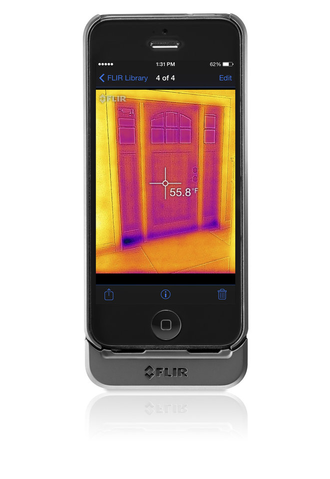 Photo - This product image provided by FLIR shows an iPhone with an attached FLIR One infrared camera. The camera for the iPhone puts thermal imaging within reach of people who probably have never considered it before, and it opens up a whole new way of looking at world. Warm things show up bright on the iPhone screen, while cold things are dark. It's like everything glows with its own light. (AP Photo/FLIR)