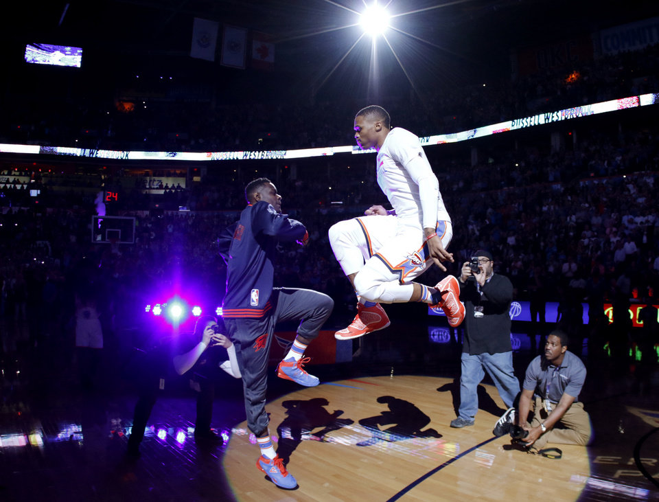 Photo - Oklahoma City's Russell Westbrook (0) is introduced before an NBA basketball game between the Oklahoma City Thunder and the San Antonio Spurs at Chesapeake Energy Arena in Oklahoma City, Wednesday, Oct. 28, 2015. Photo by Bryan Terry, The Oklahoman