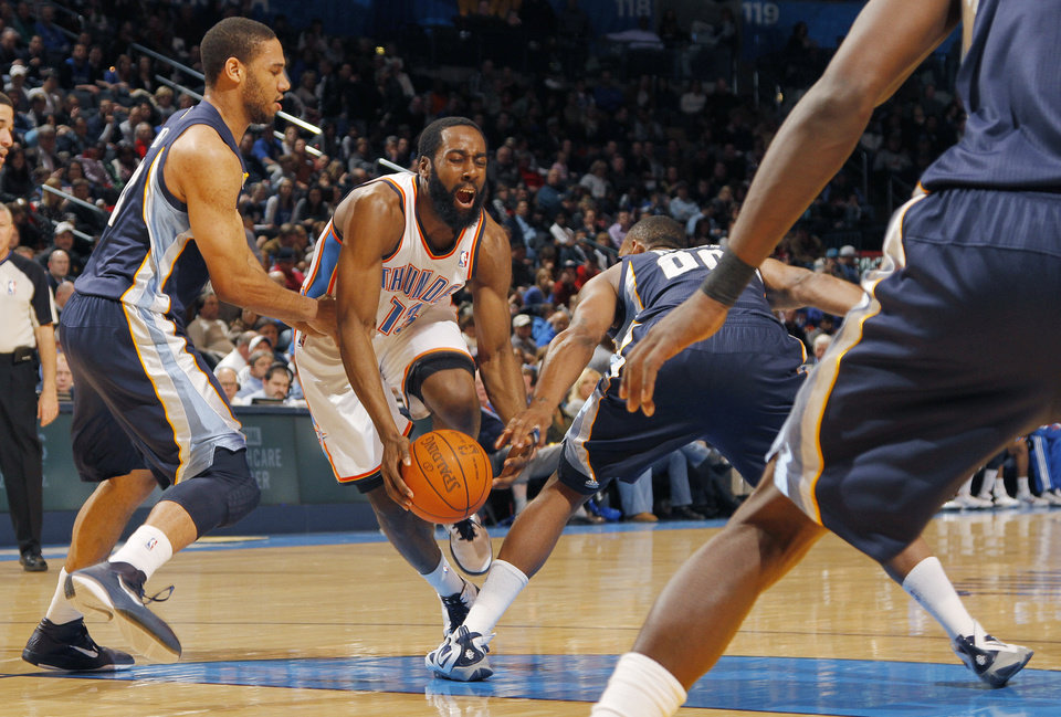 James Harden (13) is fouled by Memphis\' Darrell Arthur (00) and Xavier Henry (13) during the NBA basketball game between the Oklahoma City Thunder and the Memphis Grizzlies at the Oklahoma City Arena on Tuesday, Feb. 8, 2011, Oklahoma City, Okla. Photo by Chris Landsberger, The Oklahoman