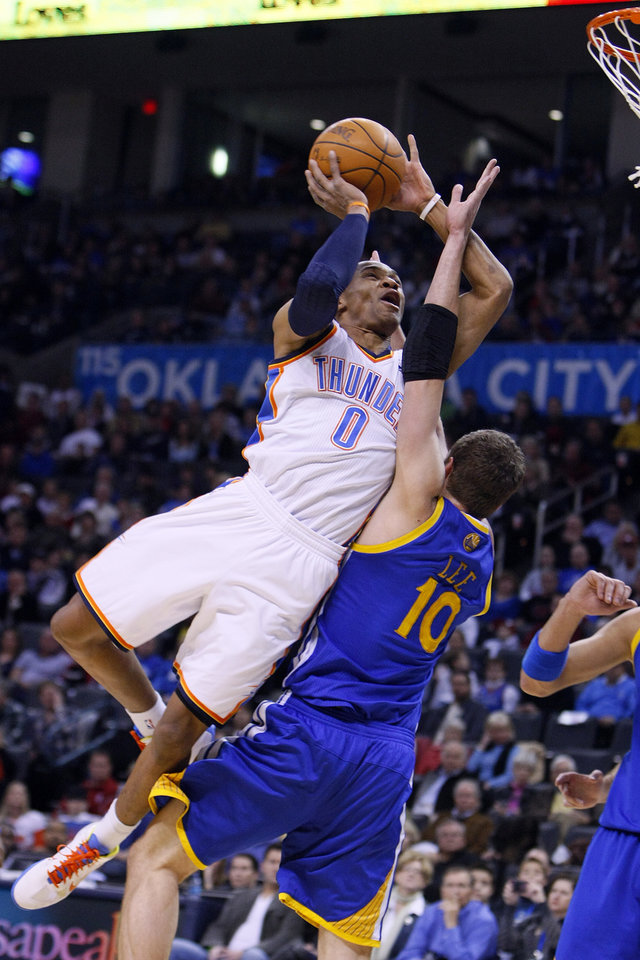 NBA BASKETBALL/NBA/OKLAHOMA CITY THUNDER/GOLDEN STATE WARRIORS Oklahoma City\'s Russell Westbrook drives into Golden State\'s David Lee during the Thunder - Warriors game Sunday, December 5, 2010 at the Oklahoma City Arena. Photo by Hugh Scott, The Oklahoman ORG XMIT: KOD