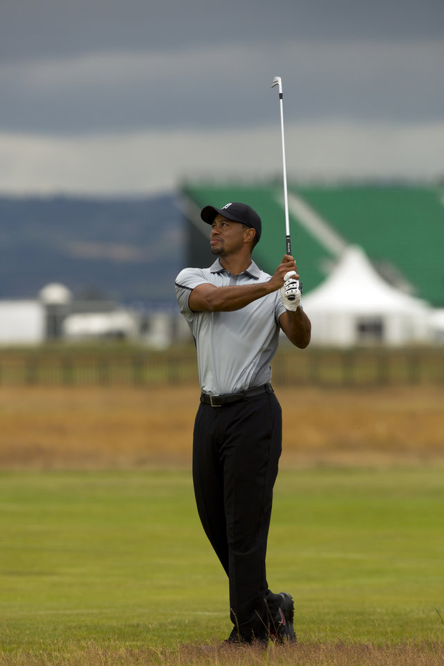 Photo - Tiger Woods of the US walks plays a shot on the 2nd fairway during a practice round at Royal Liverpool Golf Club prior to the start of the British Open Golf Championship, in Hoylake, England, Saturday, July 12, 2014. The 2014 Open Championship starts on Thursday July 17. (AP Photo/Jon Super)