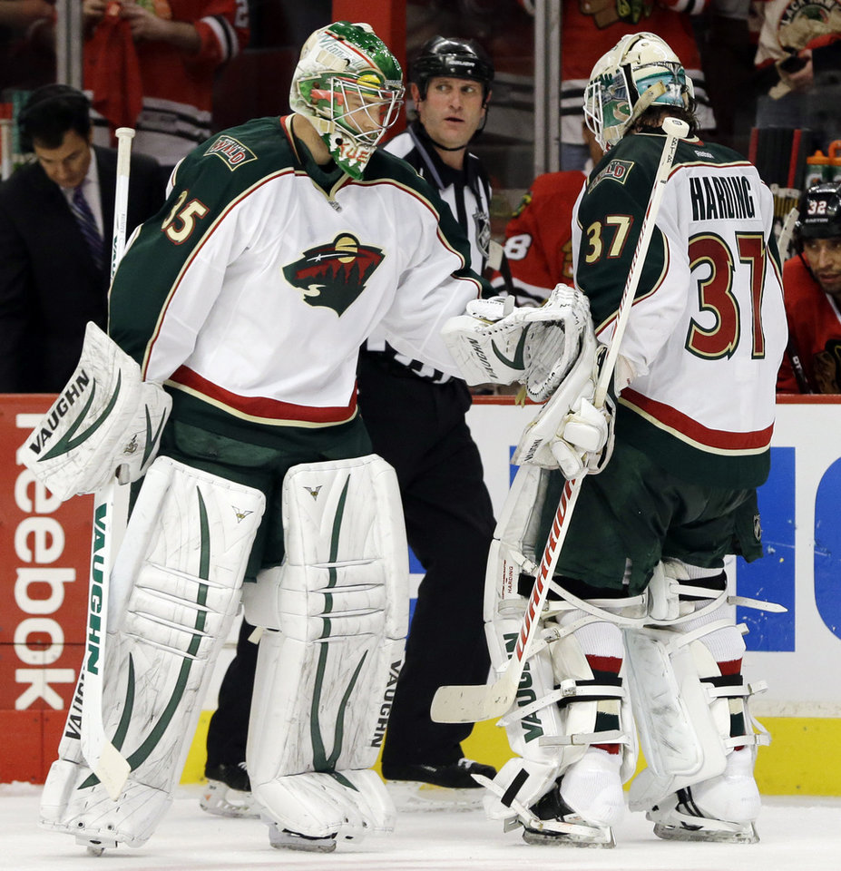Photo - Minnesota Wild goalie Darcy Kuemper (35) replaces goalie Josh Harding (37) during the second period of Game 5 of an NHL hockey Stanley Cup first-round playoff series against the Chicago Blackhawks in Chicago, Thursday, May 9, 2013. (AP Photo/Nam Y. Huh)