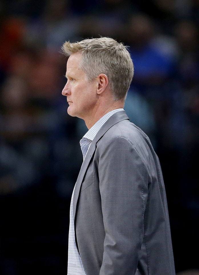 Photo - Golden State head Steve Kerr watches a play during the NBA game between the Oklahoma City Thunder and Golden State Warriors at Chesapeake Energy Arena,  Sunday, Oct. 27, 2019. Thunder won 120-92.[Sarah Phipps/The Oklahoman]