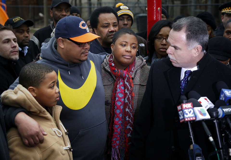 Photo - Chicago Police Superintendent Garry McCarthy, right, offers the city's condolences to the Pendelton family, from left, Nathaniel Jr., Nathaniel Sr., and Cleopatra during a news conference seeking help from the public in solving the murder of Pendelton's daughter Hadiya Wednesday, Jan. 30, 2013, in Chicago. Hadiya, 15, who had performed in President Barack Obama's inauguration festivities, was killed in a Chicago park as she talked with friends by a gunman who apparently was not even aiming at her. The city's 42nd slaying is part of Chicago's bloodiest January in more than a decade, following on the heels of 2012, which ended with more than 500 homicides for the first time since 2008. It also comes at a time when Obama, spurred by the Connecticut elementary school massacre in December, is actively pushing for tougher gun laws. (AP Photo/Charles Rex Arbogast)