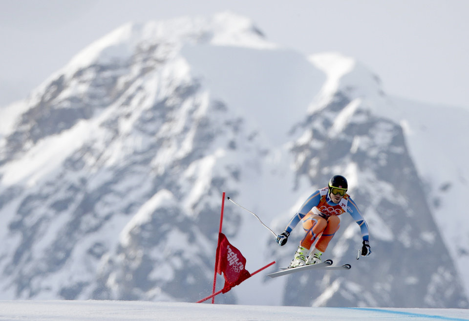 Photo - Norway's Kjetil Jansrud makes a jump in the men's super-G at the Sochi 2014 Winter Olympics, Sunday, Feb. 16, 2014, in Krasnaya Polyana, Russia. (AP Photo/Charlie Riedel)