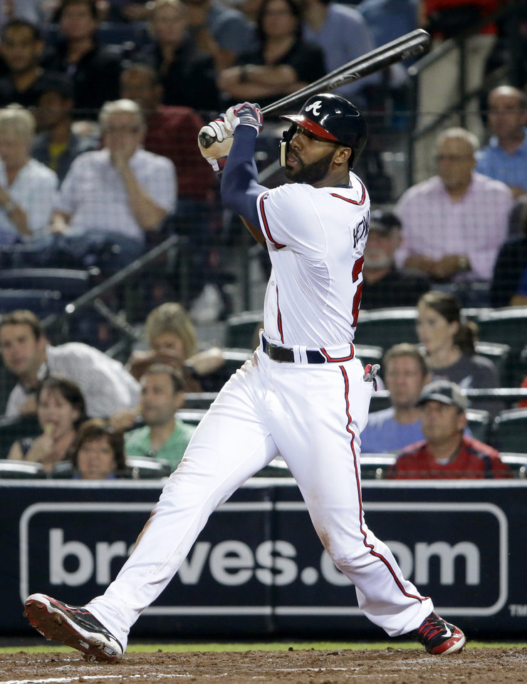 Atlanta Braves' Jason Heyward hits a double in the fifth inning of a baseball game against the Philadelphia Phillies, Thursday, Sept. 26, 2013, in Atlanta. (AP Photo/David Goldman)