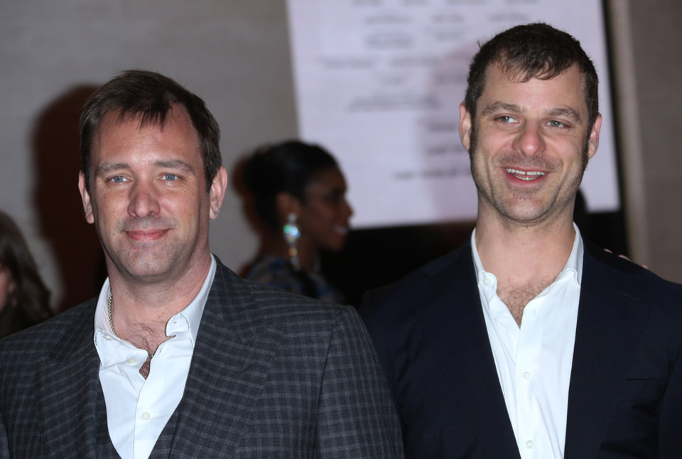 Photo - The Book of Mormon creators Trey Parker, left, and Matt Stone pose for photographers on the red carpet as they arrive for the opening night of 'The Book of Mormon' at The Prince of Wales theatre in central London, Thursday, March 21, 2013. (Photo by Joel Ryan/Invision/AP)